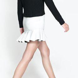 "<strong>Zara</strong> Neoprene Skirt with Frill on the Hem, <a href=""http://www.zara.com/us/en/trf/skirts/neoprene-skirt-with-frill-on-the-hem-c269213p1436044.html"">$40</a>"