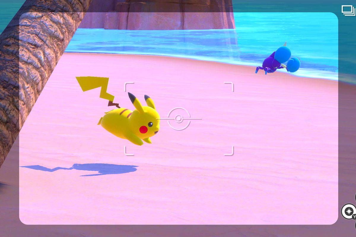 A Pikachu and Crabrawler frolic on the beach in New Pokémon Snap