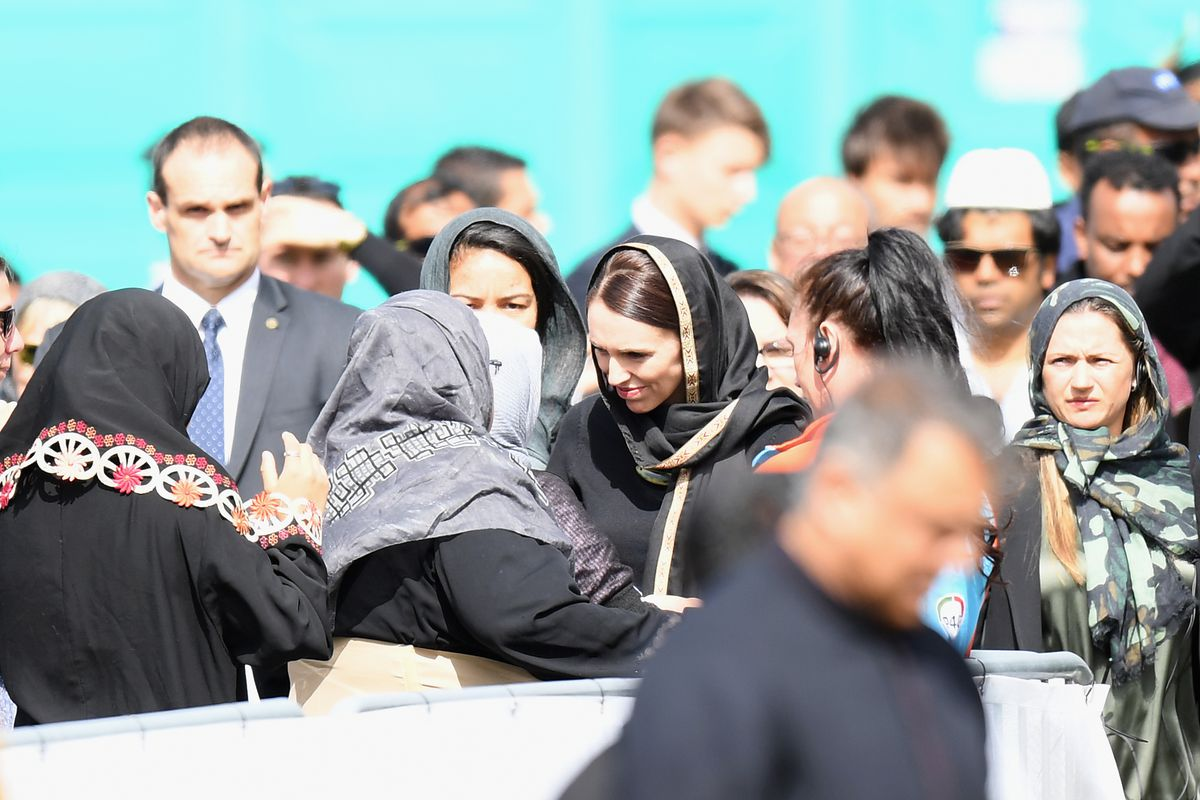 New Zealand Prime Minister Jacinda Ardern greets members of the Muslim community as she attends Islamic prayers in Hagley Park near Al Noor Mosque on March 22, 2019, in Christchurch, New Zealand.