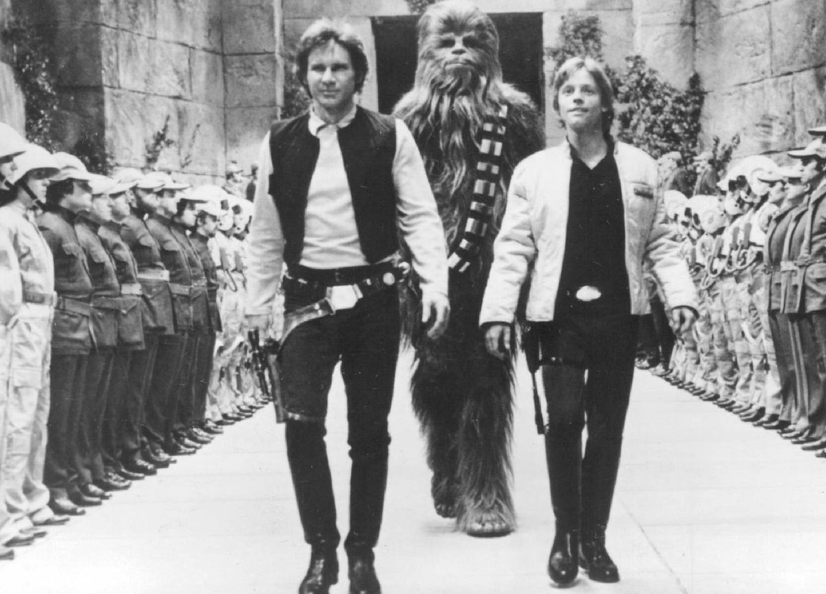 """Harrison Ford (from left) as Han Solo, Peter Mayhew as Chewbacca, and Mark Hamill as Luke Skywalker in """"Star Wars: A New Hope."""" 