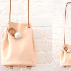 """<b>Jujumade</b> Bucket Bag in Natural, <a href=""""http://shop.creaturesofcomfort.us/jujumade-bucket-bag-natural.aspx"""">$390</a> at Creatures of Comfort"""