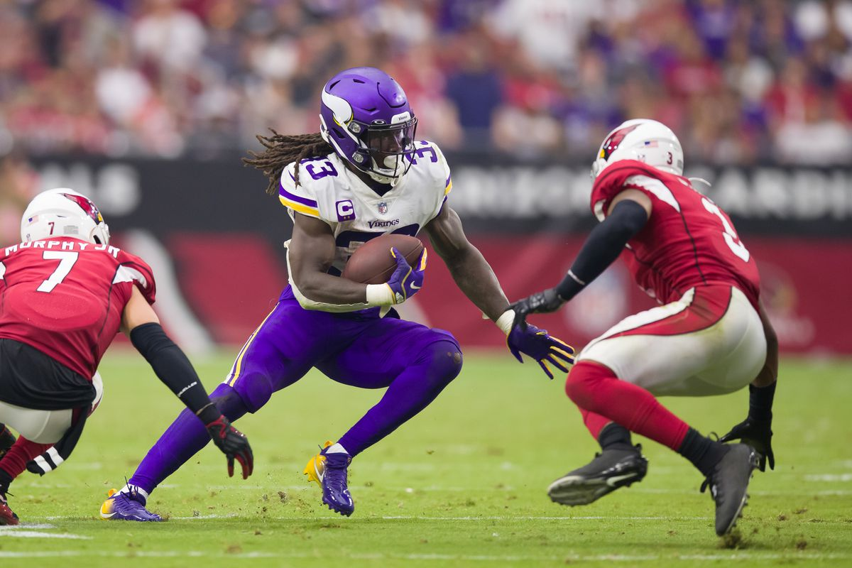 Minnesota Vikings running back Dalvin Cook (33) runs the ball against the Arizona Cardinals in the second half at State Farm Stadium.