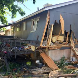 An apparent family argument resulted in a car crashing into a home in Kearns, barely missing one of the occupants who just minutes earlier had gotten out of bed and went into another room.