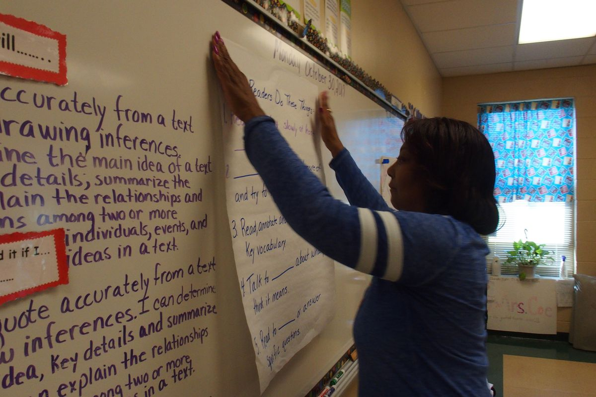 Carolyn Coe prepares her fifth-grade classroom at Winridge Elementary School for the introduction of a new curriculum in English language arts.  Expeditionary Learning is aligned with more Common Core learning standards and will offer students more complex texts to read and understand.