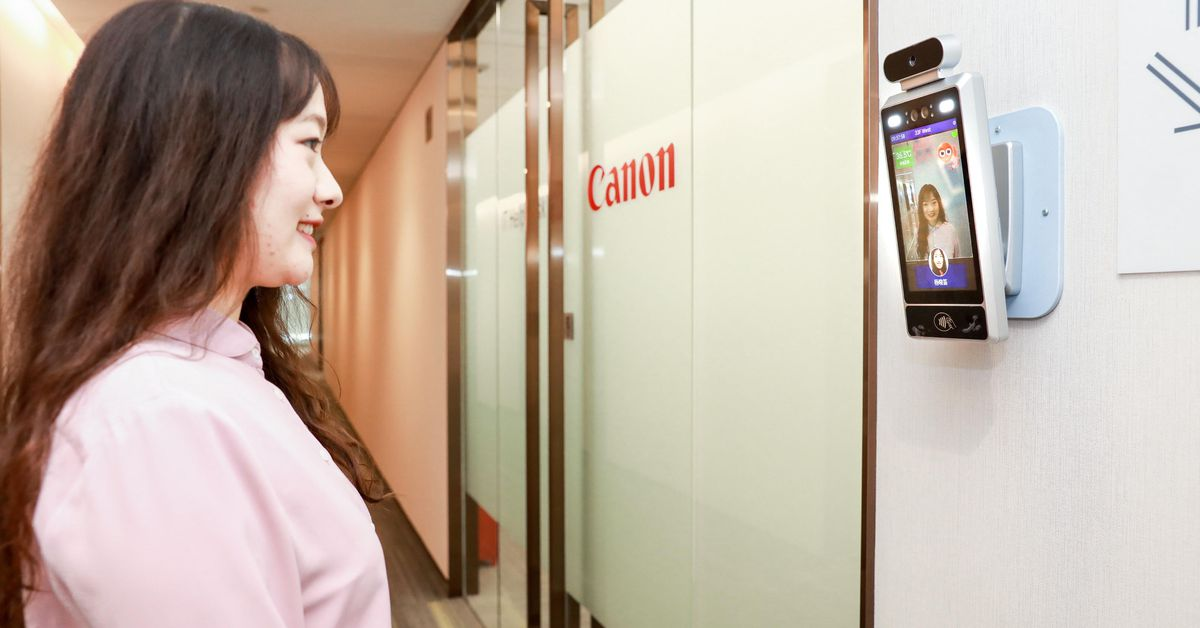 Canon put AI cameras in its Chinese offices that only let smiling workers inside - California News Times