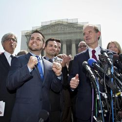 Plaintiffs in Hollingsworth v. Perry, the California Proposition 8 case, react to the 5-4 decision of the Supreme Court, Wednesday, June 26, 2013, outside the court in Washington. From left are, attorney Ted Boutrous, Jeff Zarrillo, and his partner Paul Katami, David Boies, and Sandy Stier and her partner Kris Perry. In two separate and significant victories for gay rights, the Supreme Court struck down a provision of a federal law denying federal benefits to married gay couples and cleared the way for the resumption of same-sex marriage in California.   (AP Photo/J. Scott Applewhite)