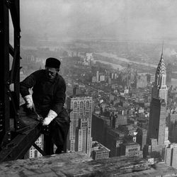"""Workman on the framework of the Empire State Building, New York City, circa 1930-31, from the Smithsonian Traveling exhibition """"The Way We Worked."""""""