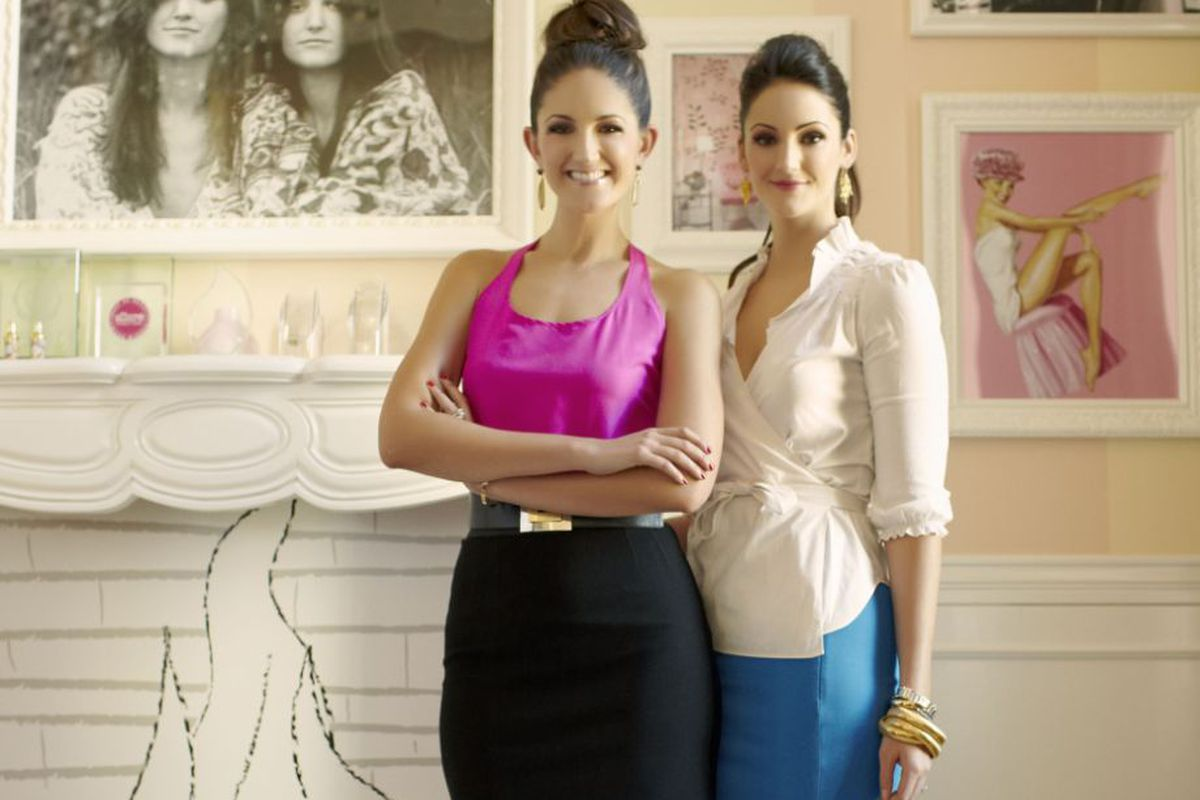 Benefit Cosmetics ambassadors Maggie (left) and Annie Ford Danielson stand in front of a photograph of founders Jean and Jane Ford. Photo: Benefit