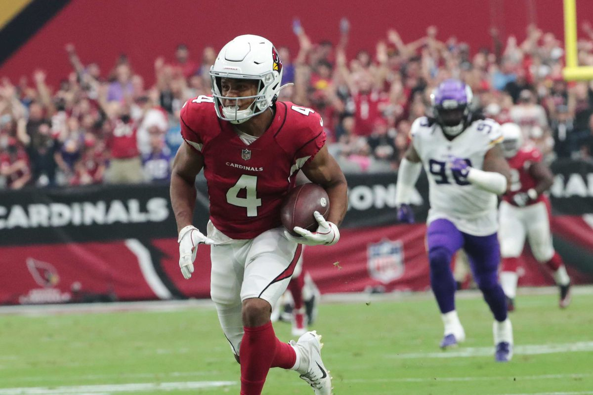 Arizona Cardinals wide receiver Rondale Moore (4) runs for a touchdown after a catch against the Minnesota Vikings during the second quarter in Glendale, Ariz. Sept. 19, 2021.