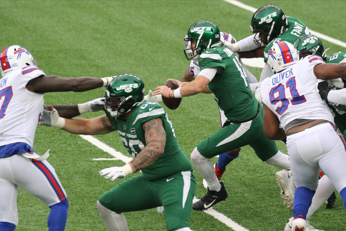 Sam Darnold of the Jets tries to avoid the sack late in the game as the Buffalo Bills met the New York Jets at Metlife Stadium in East Rutherford, New Jersey on October 25, 2020.