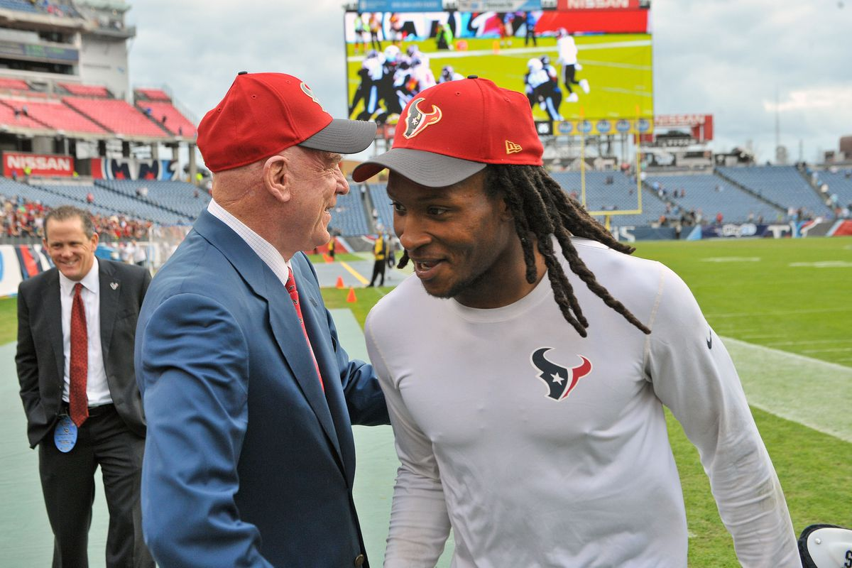 DeAndre Hopkins is greeted by Texans owner Bob McNair. Hopkins held out the first day of camp due, but reported to Day 2.