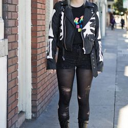 """Felicity assembled her outfit from thrift stores. She's wearing a <a href=""""http://www.dollskill.com/unif-boneyard-moto-jacket.html"""">Unif Boneyard moto jacket</a>, a D.A.R.E. t-shirt, black shorts, ripped tights, and Doc Martens boots."""
