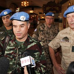 Moroccan Col. Ahmed Himmiche, foreground, is flanked by other U.N. observers as he talks to journalists before leaving the Sheraton Hotel in Damascus, Syria, Monday, April 16, 2012.