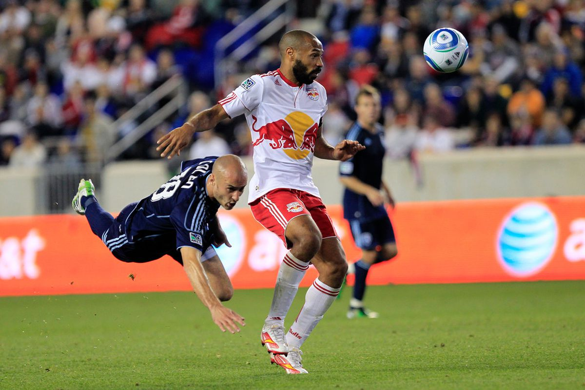 Thierry Henry (14) of the Red Bulls is pursued by Aurelien Collin (78) of the Sporting Kansas City at Red Bull Arena on April 30, 2011 in Harrison, New Jersey. The Red Bulls defeated Sporting KC 1-0. (Photo by Chris Trotman/Getty Images)