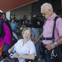 """Mary Ashcroft, left, and her husband, Wendell, talk at Skydive Ogden in Ogden on Saturday, Aug. 5, 2017. The couple have been married for 68 years """"and still counting."""""""