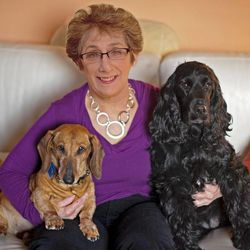 Marsha Wallace holds her dogs, Grace and Millie.