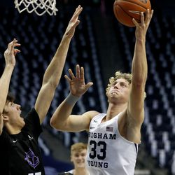 Brigham Young Cougars forward Caleb Lohner (33) drives past Portland Pilots forward Hayden Curtiss (15) at the Marriott Center in Provo on Thursday, Jan. 21, 2021.