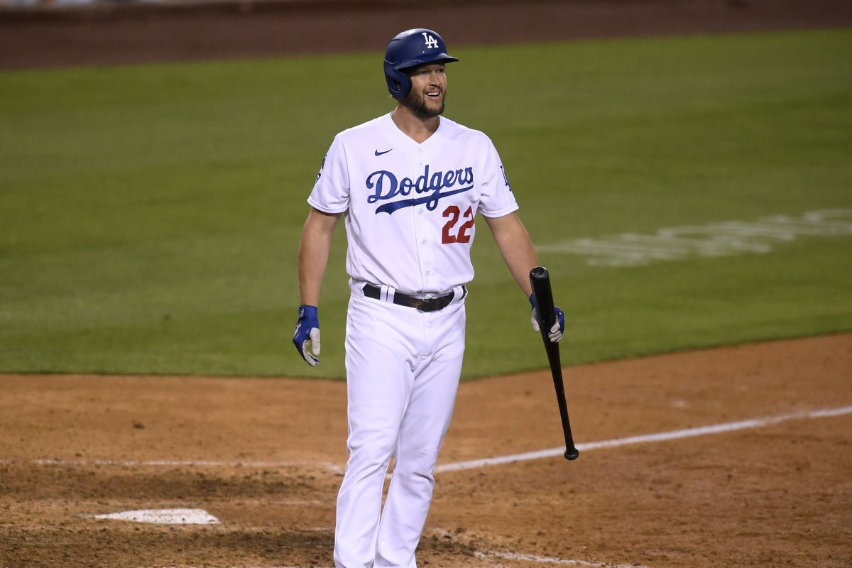 Clayton Kershaw #22 of the Los Angeles Dodgers reacts during his pinch hit at bat against the San Diego Padres during the tenth inning at Dodger Stadium on April 25, 2021 in Los Angeles, California.