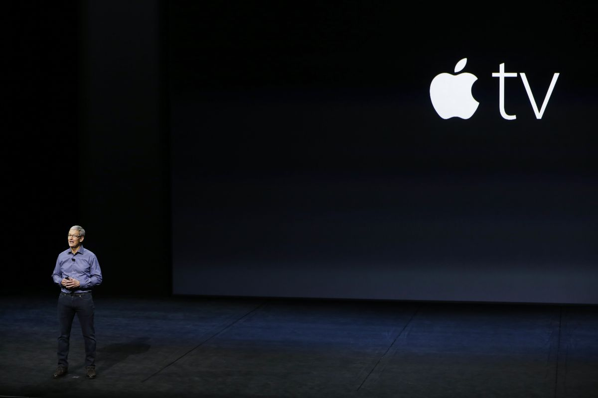 Apple CEO Tim Cook unveils new versions of iPhone 6 and Apple TV onstage.