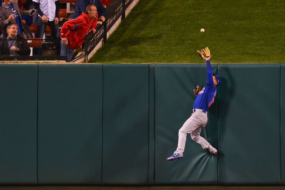 ST. LOUIS, MO - APRIL 4:  Albert Almora Jr. #5 of the Chicago Cubs prevents a home run at the wall against the St. Louis Cardinals in the seventh inning at Busch Stadium on April 4, 2017 in St. Louis, Missouri.  (Photo by Dilip Vishwanat/Getty Images)