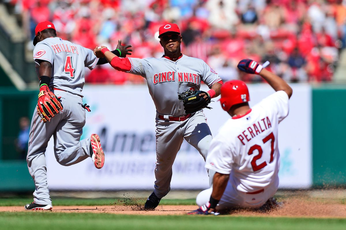 Ramon Santiago turns a double play as Jhonny Peralta slides during the eighth inning at Busch Stadium on April 9, 2014.