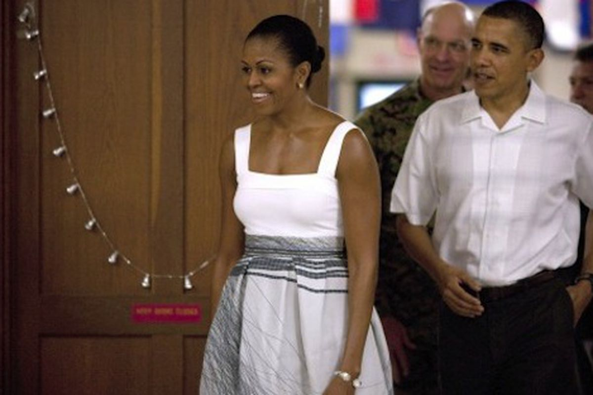 """Michelle Obama in a graphic white skirt from Jolibe's Transition 2011 collection. Image via <a href=""""http://mrs-o.org/newdata/tag/jolibe"""">Mrs. O/Press USA</a>"""
