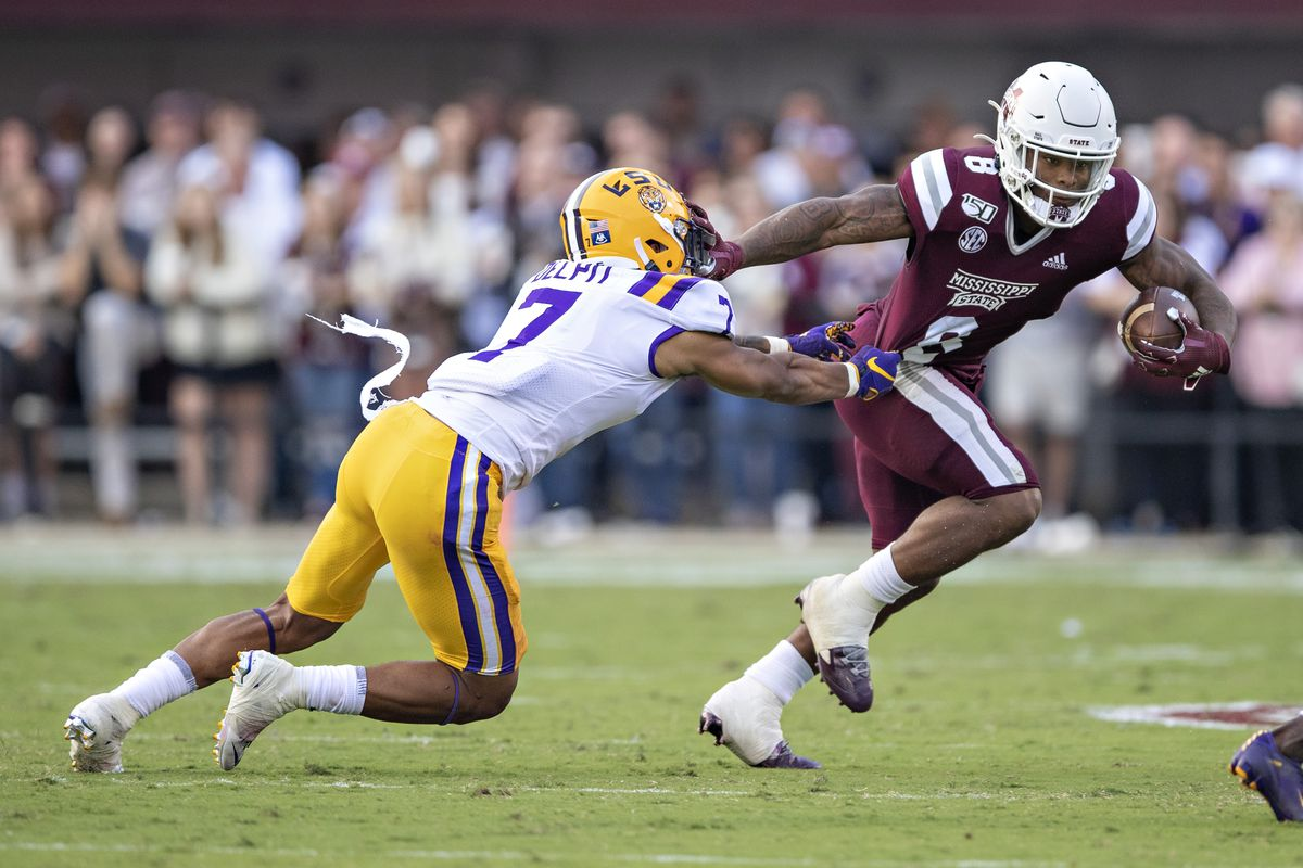 Kylin Hill #8 of the Mississippi State Bulldogs runs the ball and stiff arms Grant Delpit #7 of the LSU Tigers at Davis Wade Stadium on October 19, 2019 in Starkville, Mississippi. The Tigers defeated the Bulldogs 36-13.
