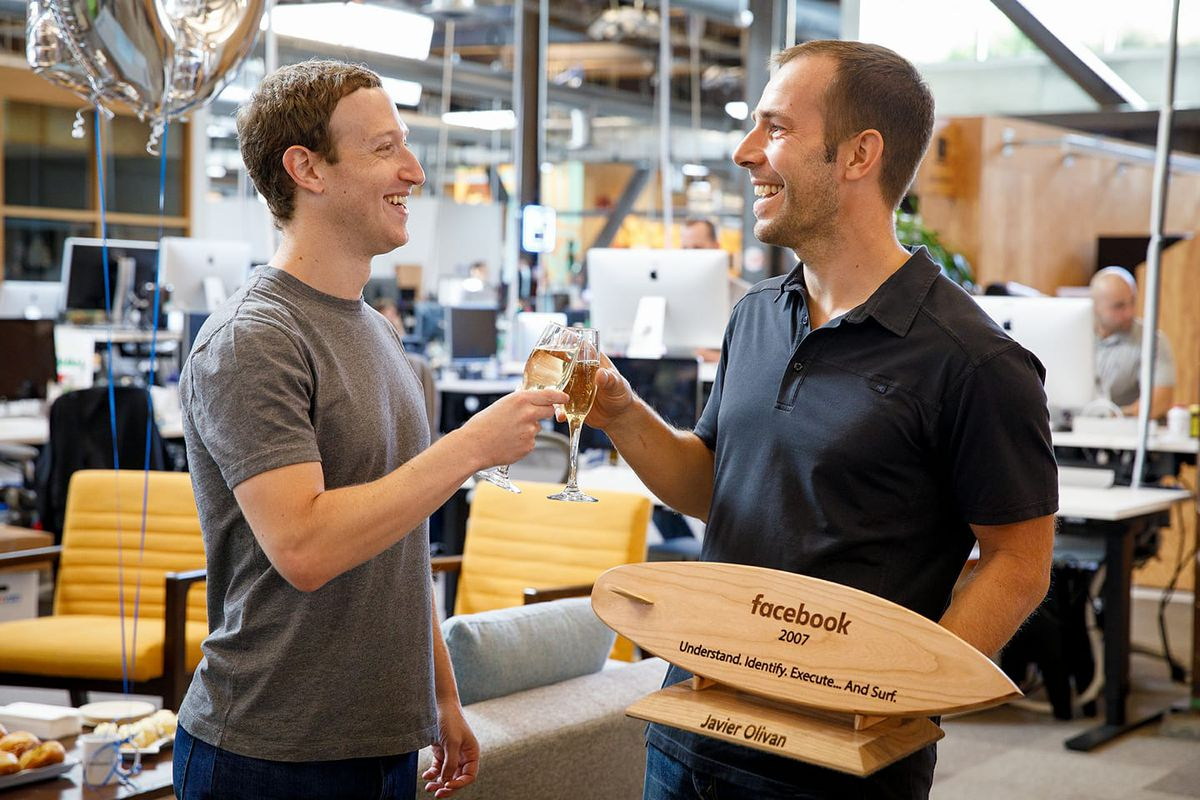 Facebook CEO Mark Zuckerberg and VP of Growth Javi Olivan clink champagne glasses on Olivan's tenth Facebook anniversary.
