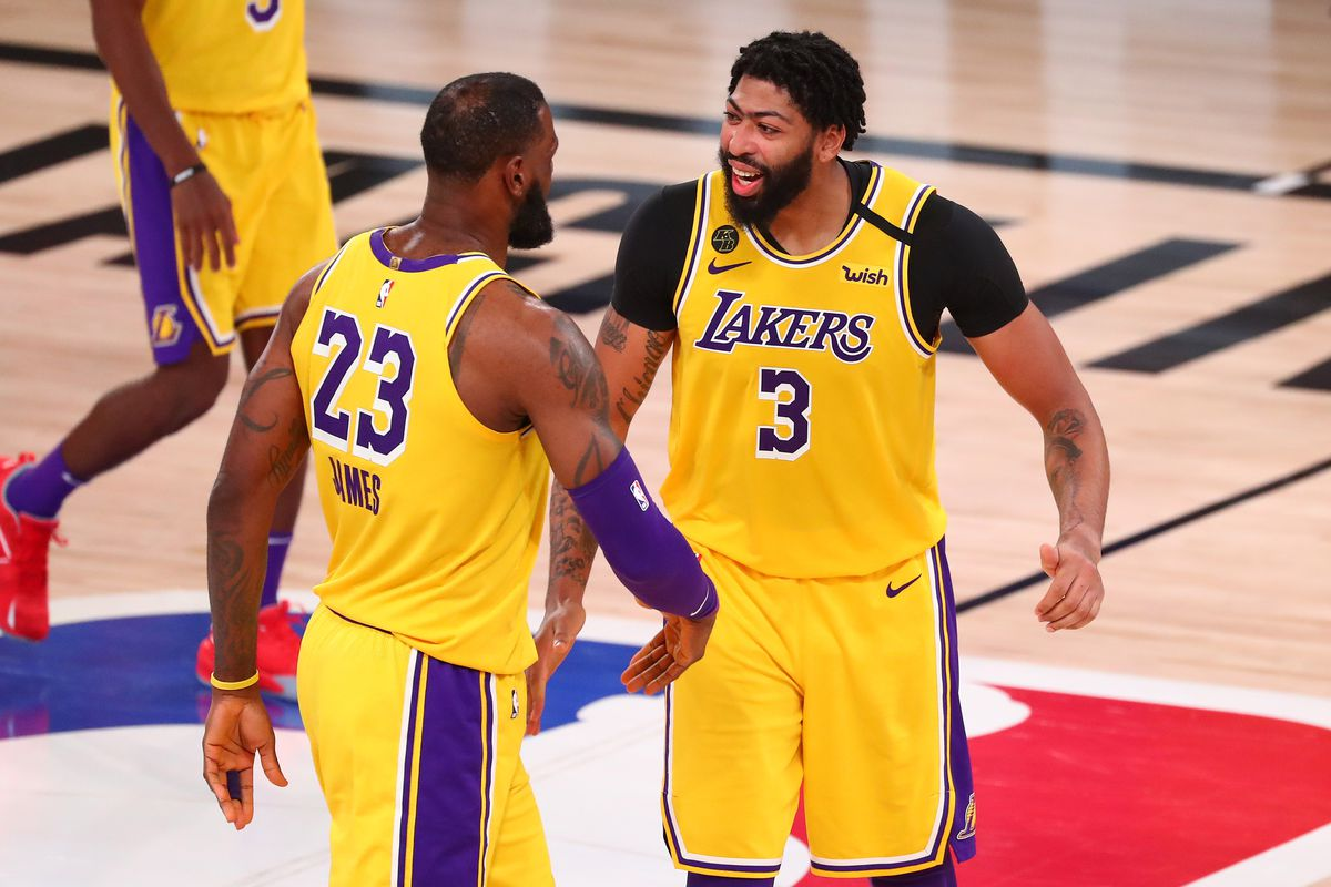 Los Angeles Lakers forward Anthony Davis celebrates with forward LeBron James after making a basket in the second half against the Houston Rockets in game four of the second round of the 2020 NBA Playoffs at AdventHealth Arena.