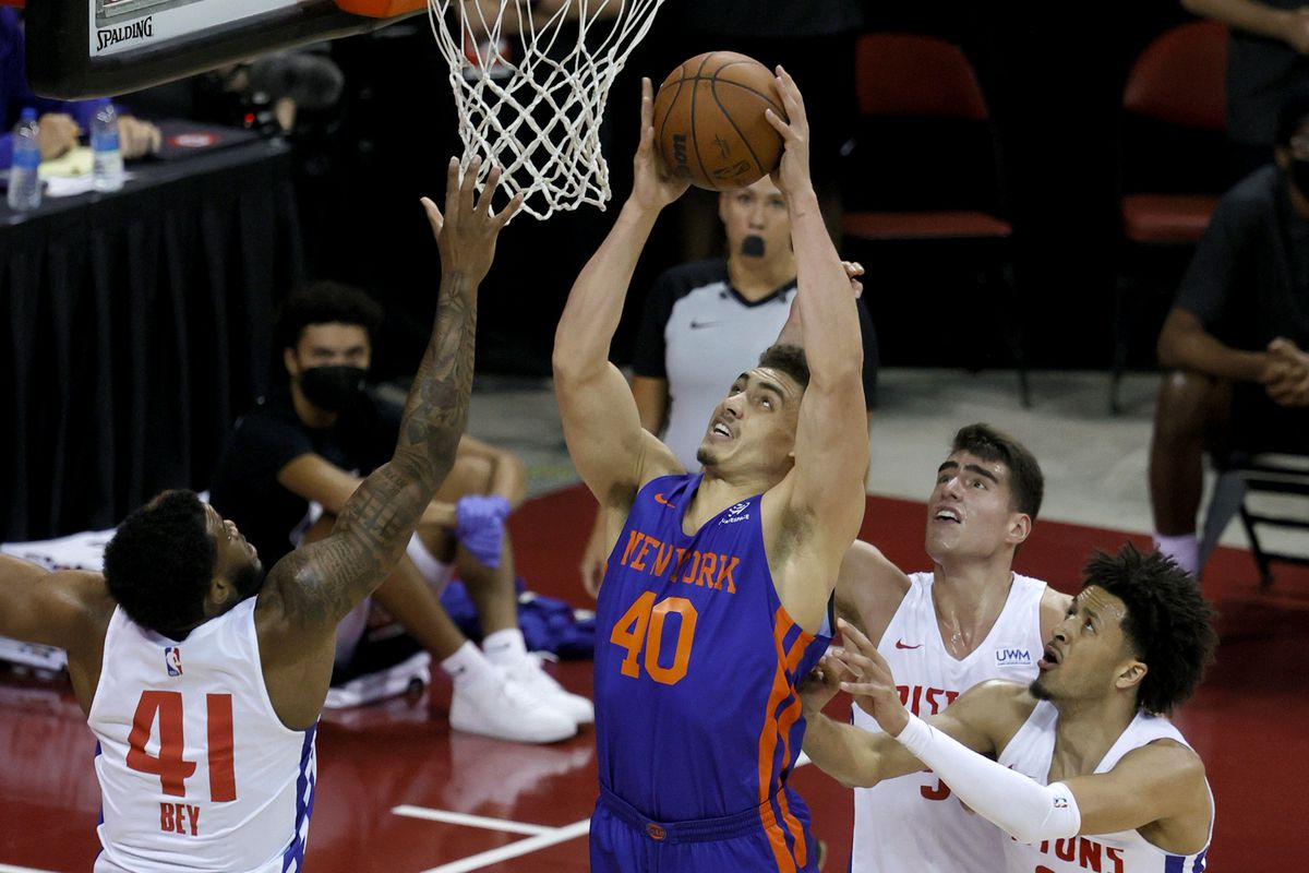 Reid Travis of the New York Knicks shoots against Saddiq Bey, Luka Garza and Cade Cunningham of the Detroit Pistons during the 2021 NBA Summer League at the Thomas & Mack Center on August 13, 2021 in Las Vegas, Nevada. The Pistons defeated the Knicks 93-87.