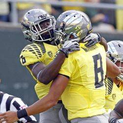 Oregon running back DeAnthony Thomas, left, celebrates his touchdown with quarterback Marcus Mariota during the first half of an NCAA college football game against Fresno State in Eugene, Ore., Saturday, Sept. 8, 2012.