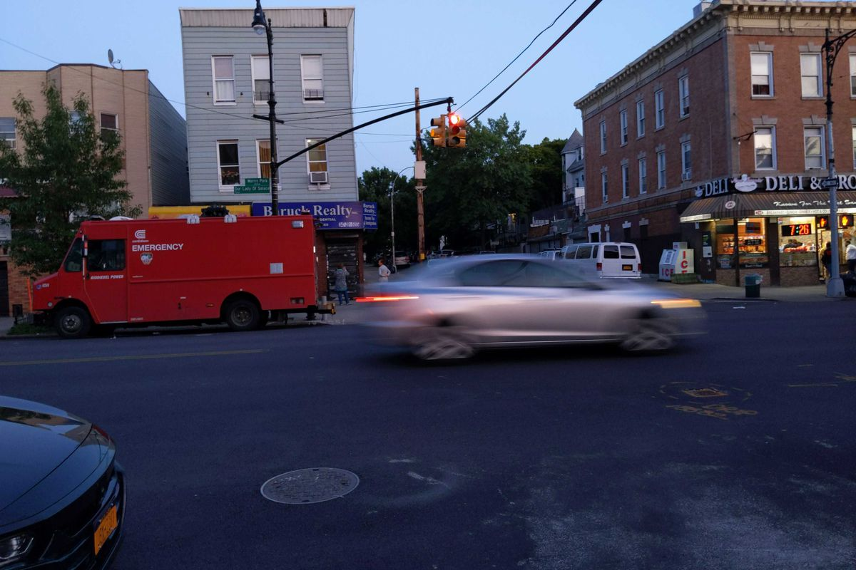 Traffic zooms past an unmarked crosswalk on Morris Park Avenue in the Bronx, June 21, 2019.