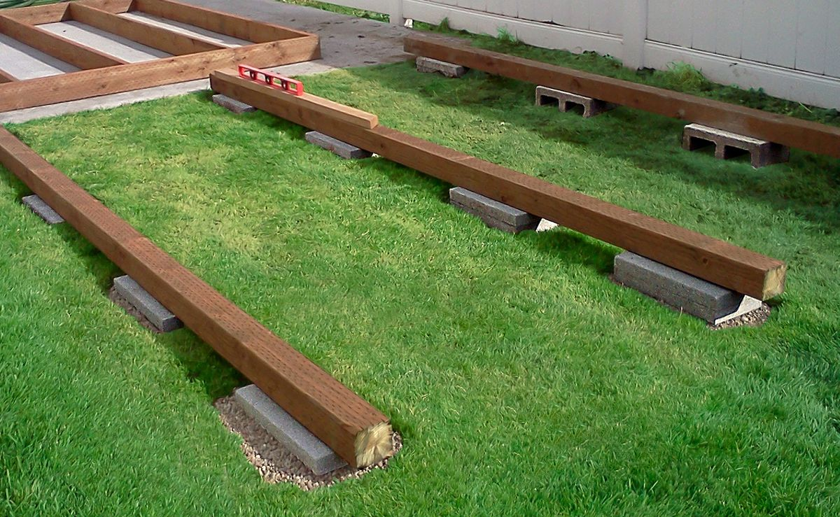 Wood Deck On Top Of Concrete Slabs As Base Of Garden Shed