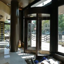 The restaurant has three doors: a revolving main door, than a door leading to the bakery, and another to the bar.