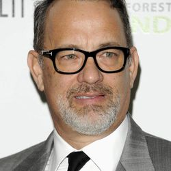 FILE - In this April 3, 2012 file photo, actor and producer Tom Hanks attends the Revlon Concert for the Rainforest Fund dinner and auction at The Pierre Hotel in New York. Beginning Thursday, many of the top digital outlets will for the first time band together to try an old TV tradition: the upfront. Over the next two weeks, YouTube, Yahoo, AOL, Hulu and others will hold their version of the annual pitch to advertisers to promote their programming slates. Yahoo has teamed with Tom Hanks for a highly-anticipated animated sci-fi series.