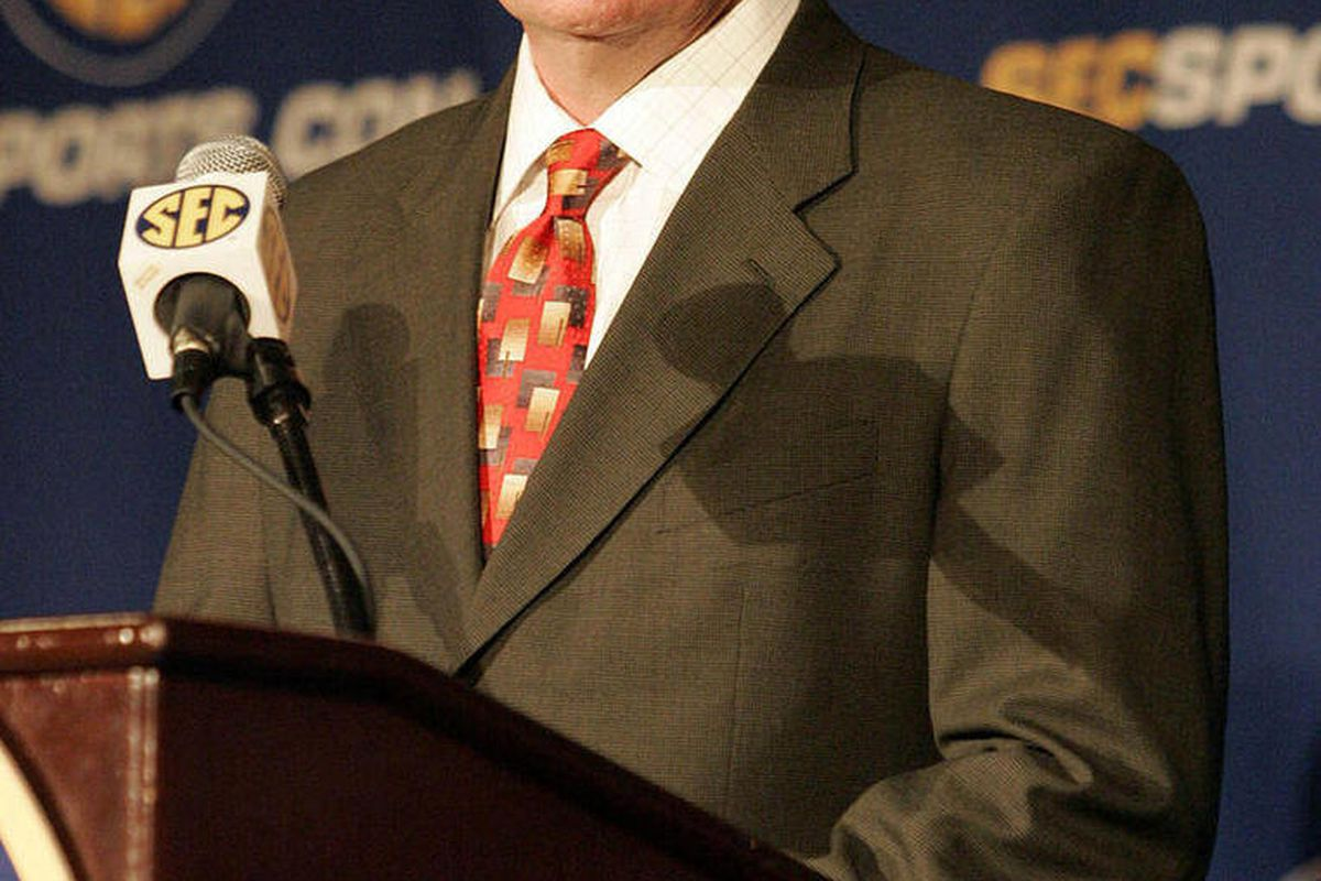 This July 22, 2009 file photo shows Arkansas football coach Bobby Petrino speaking to the media during a news conference at the SEC Media Days in Hoover, Ala. A person familiar with the situation says Petrino is out as the football coach at Arkansas. The