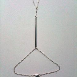 "<b>Kristen Elspeth</b> Monolith Fingerchain Bracelet, from <a href=""http://www.kristenelspeth.com/collections/bracelets/products/monolith-fingerchain-bracelet"">$121</a>"
