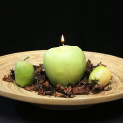 """For the creative candle collector: Laurel Elisabeth custom scented apple candle, <a href=""""https://www.etsy.com/listing/187210996/handmade-and-custom-molded-scented-apple?ref=shop_home_active_4"""">$17.50</a> at Etsy"""