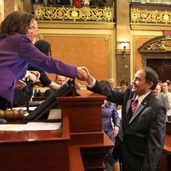 Speaker of the House Becky Lockhart, R-Provo, shakes hands with Gov. Gary R. Herbert before he delivers his 2014 State of the State address Wednesday, Jan. 29, 2014, in Salt Lake City. Lockhart, the first woman to serve as Utah House speaker, died at her home Saturday, Jan. 17, 2015, from an unrecoverable and extremely rare neurodegenerative brain disease. Lockhart she was 46.