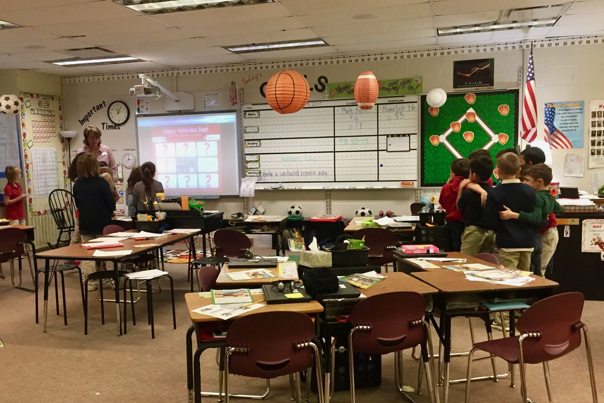 Students work in teams in a classroom at Glenns Valley Elementary School in Perry Township.