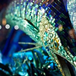 The aquarium window is made up of mosaic tile, rhinestones, and sequins.