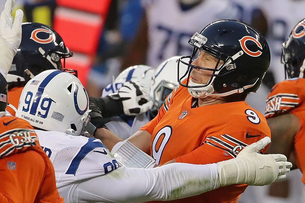 Quarterback Nick Foles is hit during the Bears' 19-11 loss to the Colts on Sunday.