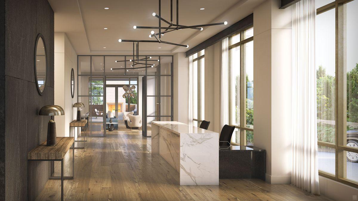 A long lobby with wood floors.