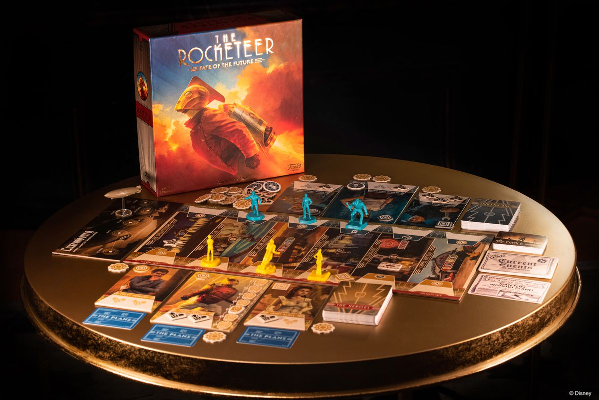 A vanity shot of the game, set on a circular side table in a dark room.