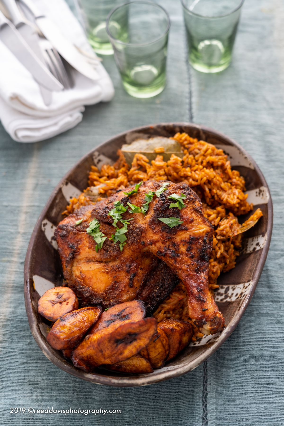 Chicken suya with jollof rice and plantains at Eko Kitchen.