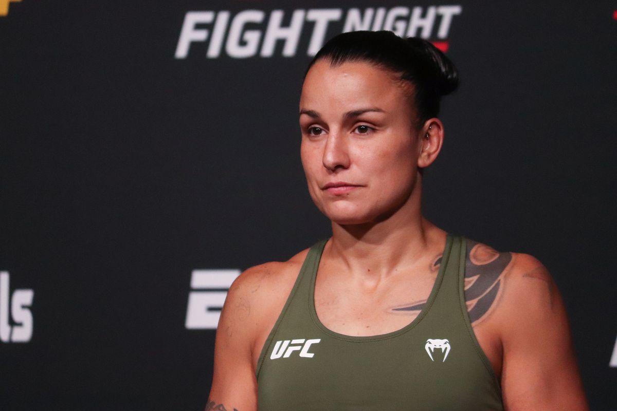 Raquel Pennington weighs in for her UFC Vegas 37 fight against Pannie Kianzad.