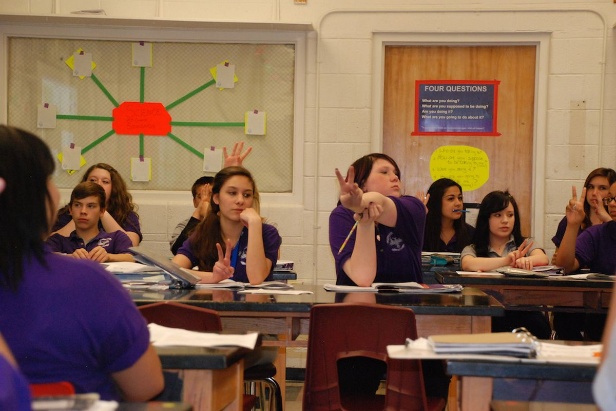 Students at the Pueblo Academy of the Arts participate in a science lesson in April 2014.