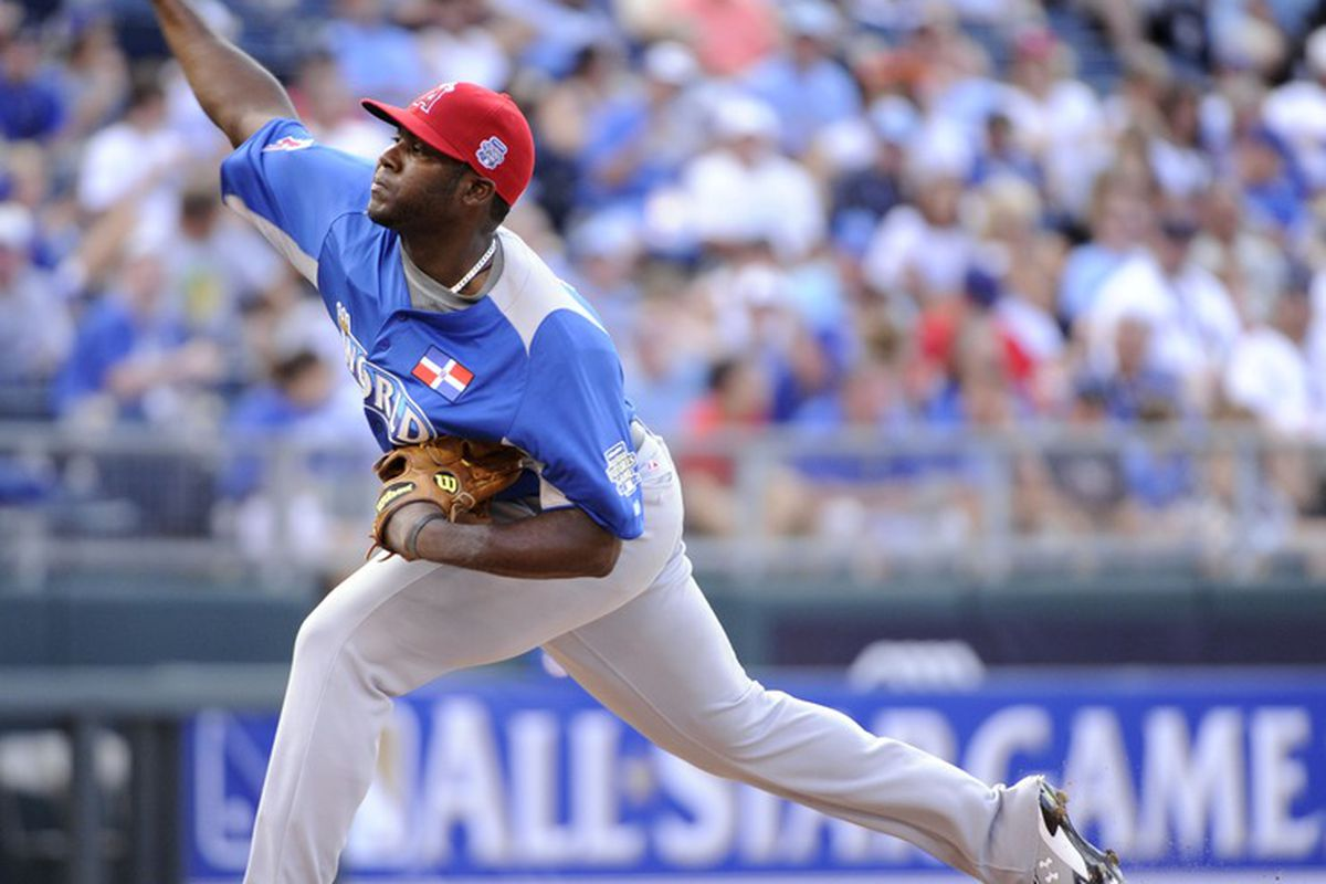 July 8, 2012; Kansas City, MO, USA; World pitcher Ariel Pena throws a pitch during the sixth inning of the 2012 All Star Futures Game at Kauffman Stadium.  Mandatory Credit: H. Darr Beiser-USA TODAY Sports via US PRESSWIRE