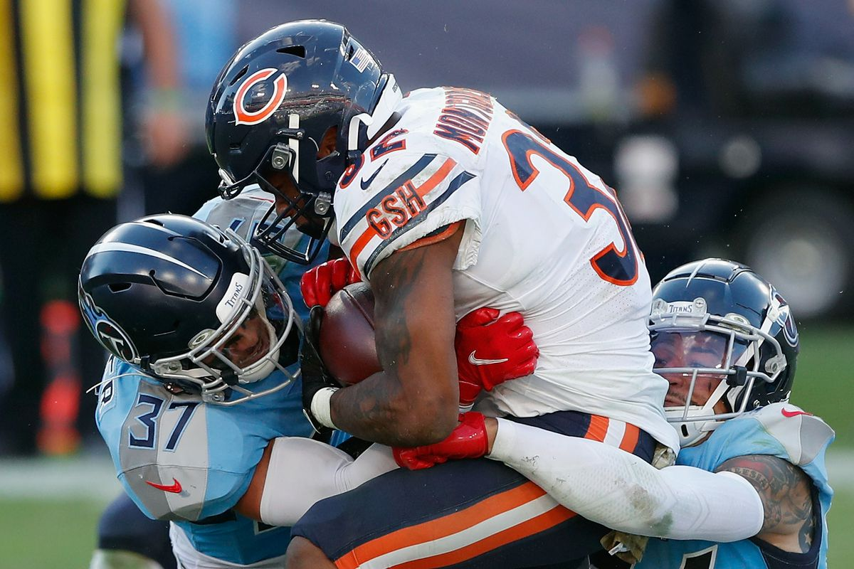 Amani Hooker #37 and Kenny Vaccaro #24 of the Tennessee Titans combine on David Montgomery #32 of the Chicago Bears during the fourth quarter at Nissan Stadium on November 08, 2020 in Nashville, Tennessee.