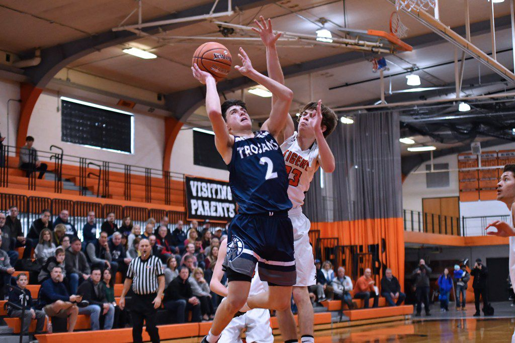 Crystal Lake's Christian Lerum (33) tries to block a shoot put up by Cary-Grove's Beau Frericks (2).